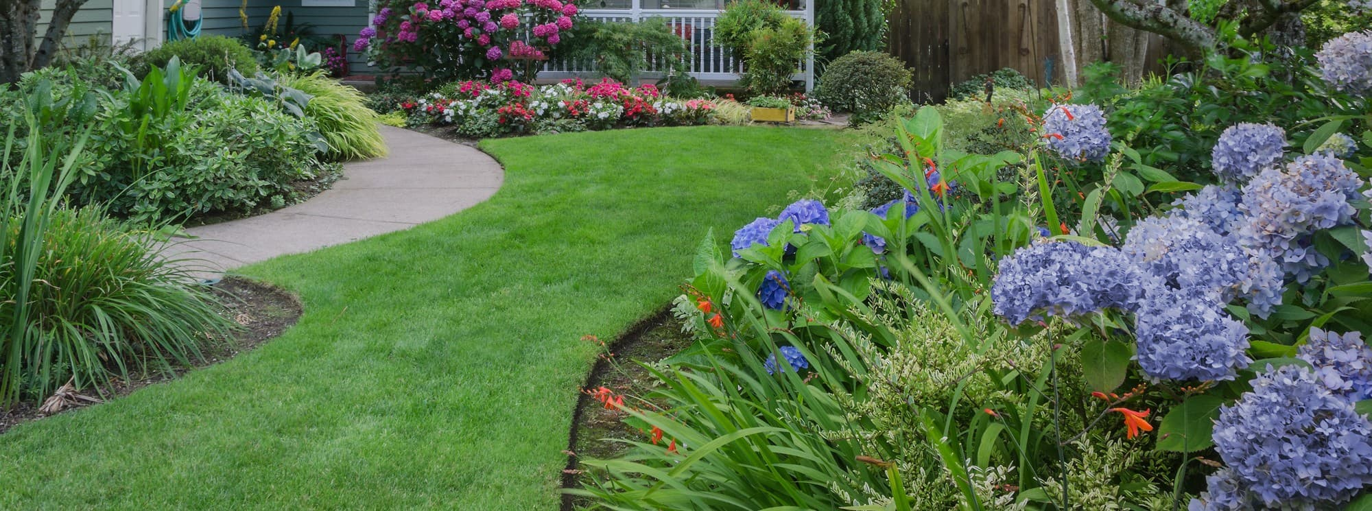 Beautifully Manicured Lawn, Path, and Flower Beds
